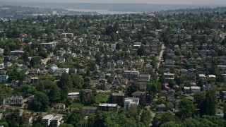 AX45_104 - 5K stock footage aerial video of flying by a suburban neighborhood in Magnolia, Seattle, Washington