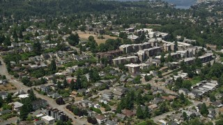 AX45_105 - 5K stock footage aerial video flyby homes to approach apartment buildings, Magnolia, Seattle, Washington