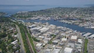 AX45_106 - 5K stock footage aerial video fly over waterfront warehouses and pan to locks in the canal, Salmon Bay, Seattle, Washington