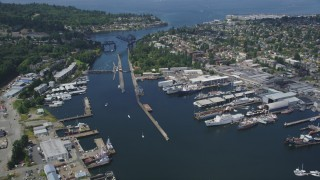 AX45_107 - 5K stock footage aerial video flyby Ballard Locks at the end of Salmon Bay, Seattle, Washington