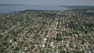 AX45_108 - 5K stock footage aerial video of following a street past suburban neighborhoods in Ballard, Washington