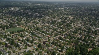 AX45_109 - 5K stock footage aerial video of flying by suburban neighborhoods, Ballard, Washington