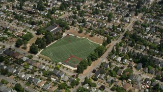 AX45_110 - 5K stock footage aerial video flyby a sports field in a suburban area, Ballard, Washington