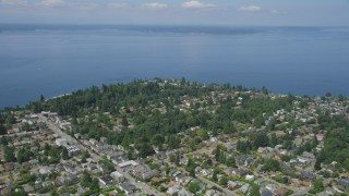 AX45_111 - 5K stock footage aerial video flyby suburban homes by the shore of Puget Sound, Ballard, Washington