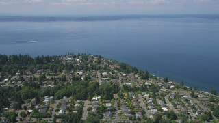 AX45_112 - 5K stock footage aerial video pass by a residential neighborhood on the shore of Puget Sound, Ballard, Washington