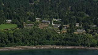AX45_116 - 5K stock footage aerial video of waterfront mansions and trees near the shore, Shoreline, Washington