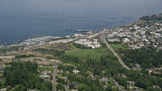 AX45_121 - 5K stock footage aerial video of approaching office buildings and piers in Edmonds, Washington