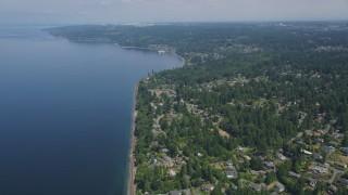 AX45_126 - 5K stock footage aerial video follow railroad tracks past a suburban neighborhood, Lynnwood, Washington