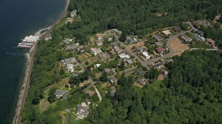 AX45_128 - 5K stock footage aerial video approach mansions by Beach Camp at Sunset Bay, Edmonds, Washington