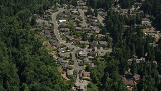 AX45_129 - 5K stock footage aerial video pass by a suburban neighborhood and trees, Lynnwood, Washington