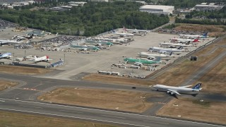 AX45_132 - Aerial stock footage of 5K aerial  video fly by parked airliners at Paine Field airport, Everett, Washington