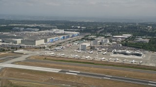 AX45_133 - 5K stock footage aerial video of airliners parked near the Boeing Factory at Paine Field airport, Everett, Washington