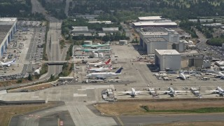 AX45_134 - 5K stock footage aerial video of airliners parked at Paine Field, Everett, Washington