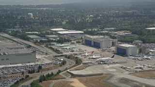 AX45_135 - 5K stock footage aerial video of rows of airplanes by the Boeing Factory at Paine Field, Everett, Washington