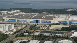 AX45_142 - 5K stock footage aerial video of Boeing Everett Factory airplane assembly building, Paine Field, Washington