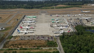 AX45_143 - 5K stock footage aerial video of approaching parked airliners at Paine Field, Washington