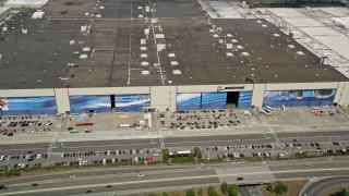 AX45_144 - 5K stock footage aerial video approach the Boeing Everett Factory and tilt to the roof, Paine Field, Everett, Washington