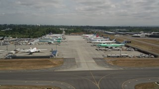 AX45_150 - 5K stock footage aerial video of rows of commercial airplanes parked at Paine Field, Washington