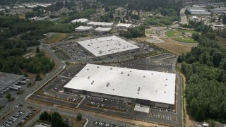 AX46_004 - 5K stock footage aerial video fly over a pair of large warehouse buildings in Lynnwood, Seattle, Washington