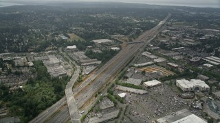 AX46_010 - 5K stock footage aerial video flyby Interstate 5 with light traffic by shopping centers, Lynnwood, Washington