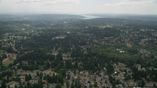 AX46_011 - 5K stock footage aerial video fly over suburban neighborhoods with trees, Brier, Washington