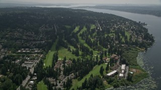 AX46_016 - 5K stock footage aerial video tilting to a bird's eye view of Inglewood Golf Club by Lake Washington, Kenmore, Washington