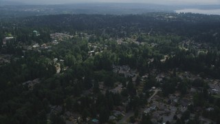 AX46_017 - 5K stock footage aerial video flying over trees and suburban neighborhoods, Kenmore, Washington