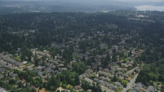 AX46_018 - 5K stock footage aerial video flying over suburban house and trees in Kenmore, Washington