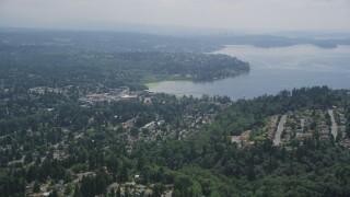 AX46_020 - 5K stock footage aerial video flying by a residential neighborhood on the shore of Lake Washington, Kirkland, Washington