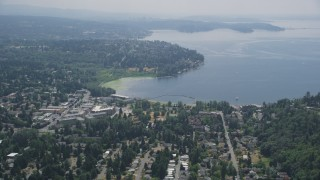 AX46_021 - 5K stock footage aerial video flying by apartment complexes and suburban homes by the shore of Lake Washington, Kirkland, Washington