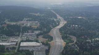 AX46_024 - 5K stock footage aerial video of light traffic on Interstate 405 through Kirkland, Washington