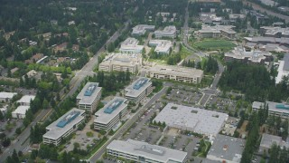 AX46_032 - 5K stock footage aerial video flying by office buildings at Microsoft Headquarters, Redmond, Washington