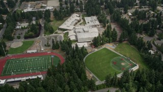 AX46_038 - 5K stock footage aerial video flying by sports fields and Interlake High School, Bellevue, Washington