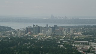 AX46_039 - 5K stock footage aerial video of skyscrapers in Downtown Bellevue, Seattle skyline in the far distance, Washington