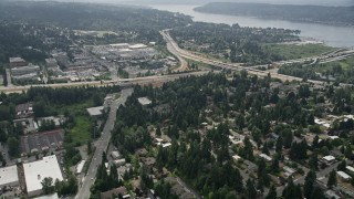 AX46_043 - 5K stock footage aerial video tilt to suburban homes near a freeway interchange, Bellevue, Washington