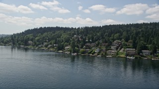 AX46_048 - 5K stock footage aerial video of flying by lakeside homes with docks on the lake, Mercer Island, Washington