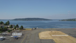 AX47_001 - 5K stock footage aerial video take off from Renton Municipal Airport and fly over Lake Washington toward Mercer Island, Washington
