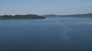 AX47_003 - 5K stock footage aerial video fly over Lake Washington to approach Mercer Island, Washington