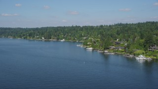 AX47_004 - 5K stock footage aerial video flyby Mercer Island lakeside homes with docks, Washington