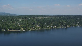 AX47_006 - 5K stock footage aerial video of waterfront homes on the shore of Lake Washington, Mercer Island, Washington