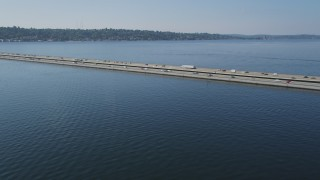 AX47_011 - 5K stock footage aerial video approach and pan across Lacey V. Murrow Memorial Bridge spanning Lake Washington, Washington