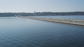 AX47_012 - 5K stock footage aerial video flyby and pan across light traffic on bridge over Lake Washington, Washington