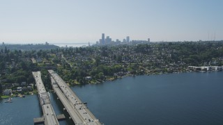 AX47_013 - 5K stock footage aerial video fly over light bridge traffic to reveal the Downtown Seattle skyline, Washington