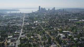 AX47_015 - 5K stock footage aerial video tilt from park to reveal urban homes in Central Seattle and the Downtown Seattle skyline, Washington