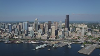AX47_037 - 5K stock footage aerial video approach Downtown Seattle skyline and fly over the Seattle Ferry Terminal on the Waterfront, Washington