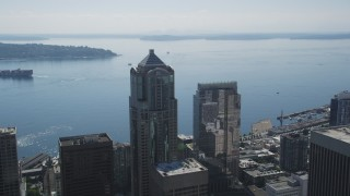 AX47_046 - 5K stock footage aerial video fly over skyscrapers, reveal and tilt to the Seattle Great Wheel and aquarium, Downtown Seattle, Washington