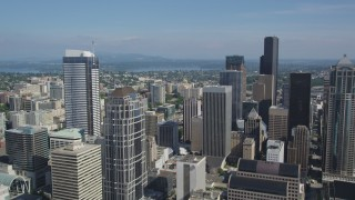 AX47_055 - 5K stock footage aerial video fly over downtown high-rises to approach taller skyscrapers in Downtown Seattle, Washington