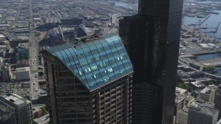 AX47_057 - 5K stock footage aerial video orbit the roof of Seattle Municipal Tower in Downtown Seattle, Washington