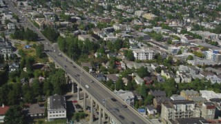 AX47_067 - 5K stock footage aerial video fly over Lake Union to approach Aurora Bridge and light traffic crossing the span, Seattle, Washington