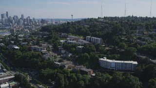 AX47_068 - 5K stock footage aerial video approach and fly over bridge spanning Lake Union, reveal Downtown Seattle skyline, Washington